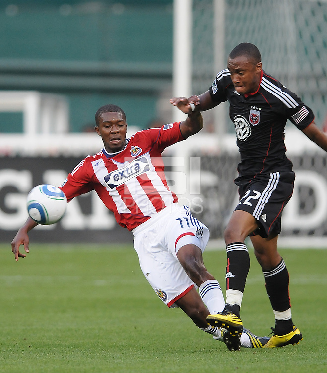 Chivas USA midfielder Michael Lahoud (11) shields the ball against DC United defender Rdoney Wallace (22).  DC United defeated Chivas USA 3-2 at RFK Stadium, Saturday May 29, 2010.