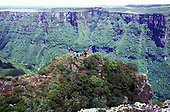 Fortaleza, Rio Grande do Sul State, Brazil. Spectacular view of the canyon; two people on the top of high rock.