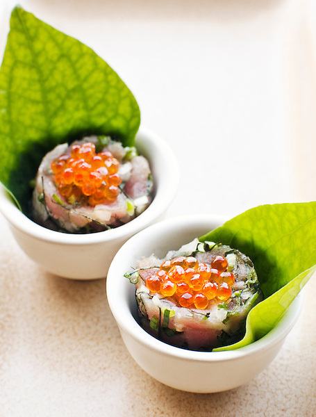 Spicy tuna tartar with lime juice, chili and roasted rice, a healthy, low-calorie Thai tapas dish created by Executive Chef Marcus Hume. Thailand.