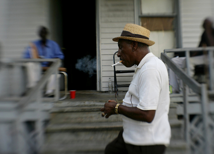 "Driving Detroit..J. R. (""Snoop"" ) Frazier, 67 , lights up at his friend's house at 1239 Concord St. just east of St. Paul,  Sunday, October7, 2007. Frazier has lived in Detroit since 1943, and is retired from Ford Motor Co. where he worked for 33 years...SUSAN TUSA/Detroit Free Press"