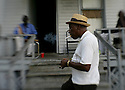 """Driving Detroit..J. R. (""""Snoop"""" ) Frazier, 67 , lights up at his friend's house at 1239 Concord St. just east of St. Paul,  Sunday, October7, 2007. Frazier has lived in Detroit since 1943, and is retired from Ford Motor Co. where he worked for 33 years...SUSAN TUSA/Detroit Free Press"""