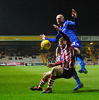 Lincoln City's Michael O'Connor is fouled by Morecambe's Kevin Ellison<br /> <br /> Photographer Chris Vaughan/CameraSport<br /> <br /> The EFL Sky Bet League Two - Saturday 15th December 2018 - Lincoln City v Morecambe - Sincil Bank - Lincoln<br /> <br /> World Copyright © 2018 CameraSport. All rights reserved. 43 Linden Ave. Countesthorpe. Leicester. England. LE8 5PG - Tel: +44 (0) 116 277 4147 - admin@camerasport.com - www.camerasport.com