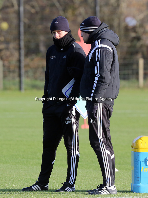 Pictured L-R: Manager Garry Monk with assistant Josep Clotet Wednesday 10 December 2014<br /> Re: Swansea City FC training at Fairwood Training Ground, south Wales, UK