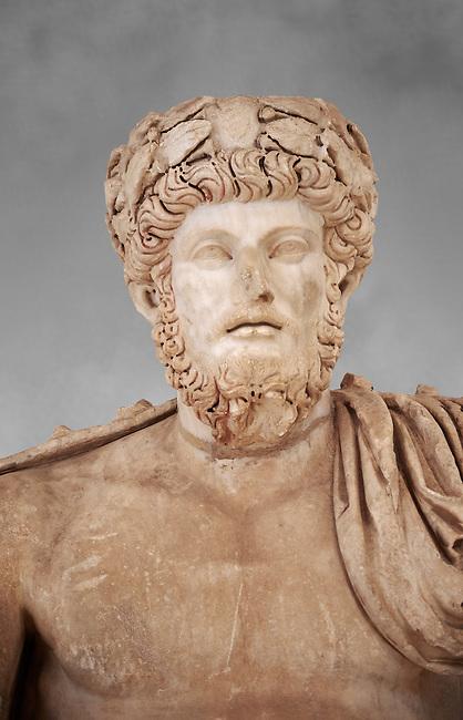 Roman sculpture of the Emperor Lucius Verus, excavated from Bulla Regia Theatre, sculpted circa 161-169 AD. The Bardo National Museum, Tunis. Against a grey art background.