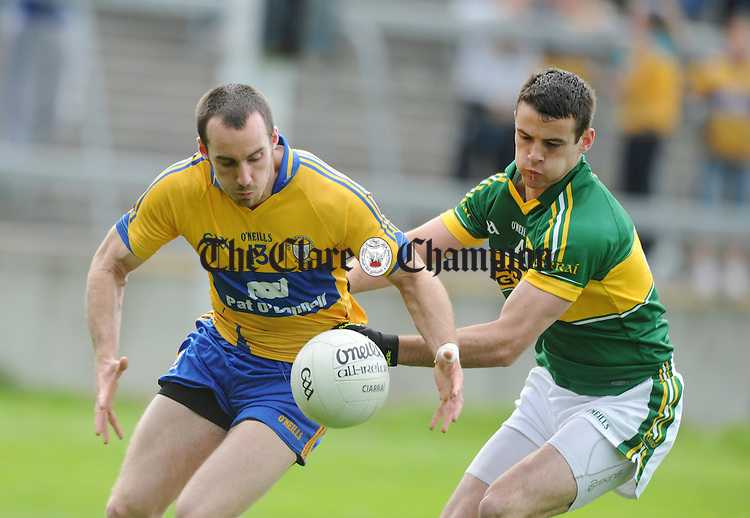 Clare's Rory Donnelly gains posession under pressure from Shane Enright. Photograph by Declan Monaghan