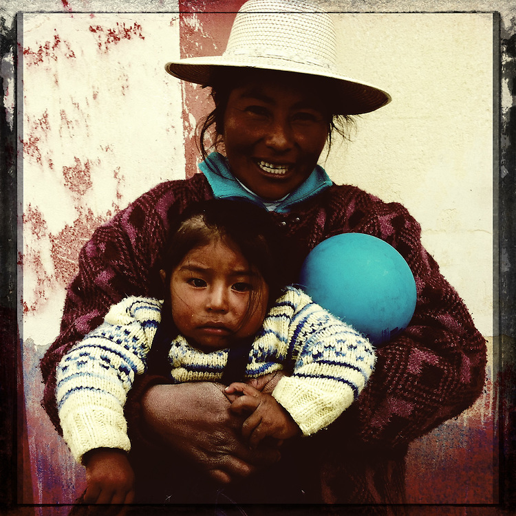 Woman holds girl at a CARE preschool near Puno, Peru
