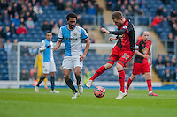 BLACKBURN, ENGLAND - JANUARY 24:  Gylfi Sigurosson of Swansea City moves the ball away from Lee Williamson of Blackburn Rovers  during the FA Cup Fourth Round match between Blackburn Rovers and Swansea City at Ewood park on January 24, 2015 in Blackburn, England.  (Photo by Athena Pictures/Getty Images)