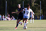 CARY, NC - APRIL 08: North Carolina's Maya Worth (5) pushes Courage's Ashley Hatch (left) off of the ball. The NWSL's North Carolina Courage played a preseason game against the University of North Carolina Tar Heels on April 8, 2017, at WakeMed Soccer Park Field 3 in Cary, NC. The Courage won the match 1-0.