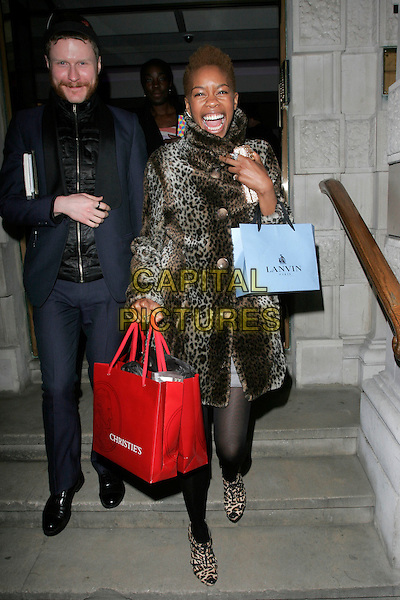GUEST & TOLULA ADEYEMI .The Lighthouse Gala Charity Auction in aid of the Terrence Higgins Trust, at Christie's, London, England. .March 23rd, 2009.full length silver grey gray silk satin dress black tights leopard print coat shoes ankle booties pink jewel encrusted clutch bag goody bag.CAP/AH.©Adam Houghton/Capital Pictures.