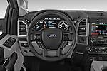 Steering Wheel View of 2015 Ford F-150 XLT Super Cab 2 Door Truck Stock Photo