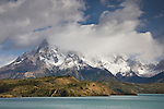 Paine Grande, the tallest peak in Torres del Paine National Park at 10,004 ft-3050 m, hides behind a curtain of clouds, Patagonia, Chile