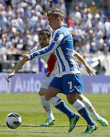 Rayo Vallecano's Javi Fuego (l) and Real Sociedad's Antoine Griezman during La Liga match.April 14,2013. (ALTERPHOTOS/Acero)