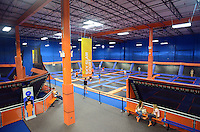 LEVITTOWN, PA - AUGUST 19: Children jump on trampolines at the grand opening of Sky Zone Indoor Trampoline Park August 19, 2014 in Levittown, Pennsylvania. A portion of the grand opening day proceeds to Alex's Lemonade Stand Foundation. (Photo by William Thomas Cain/Cain Images)
