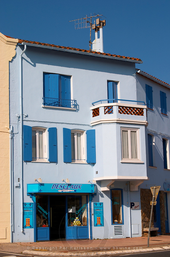 Desclaux Anchois anchovies factory and shop, house painted with advertising in blue and white. Collioure. Roussillon. France. Europe.
