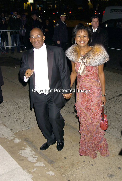 Al Roker and Deborah Roberts..at the Wedding of Star Jones and Al Reynolds on November 13, 2004 at St Barts Church in New York City. ..Photo by Robin Platzer, Twin Images