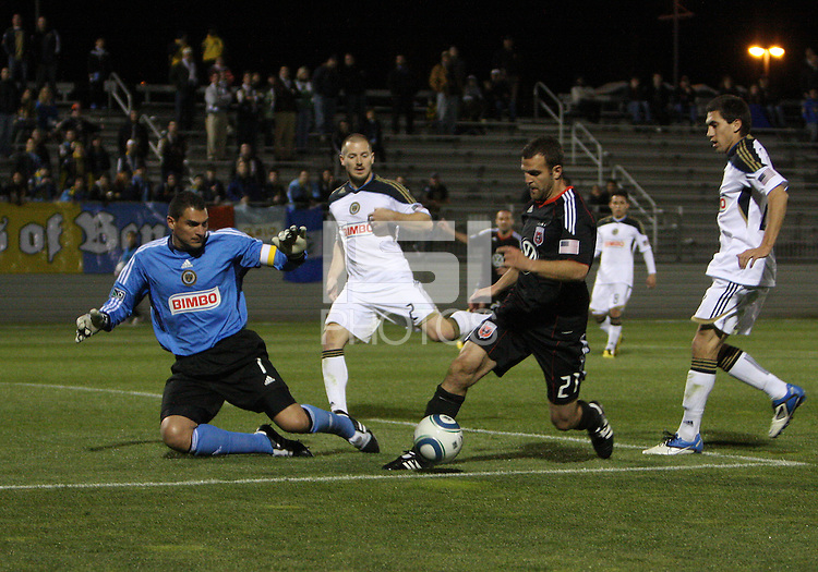 Daniel Woolard(21) of D.C. United moves the ball away from Faryd Mondragon(1) of the Philadelphia Union during a play-in game for the US Open Cup tournament at Maryland Sportsplex, in Boyds, Maryland on April 6 2011. D.C. United won 3-2 after overtime penalty kicks.