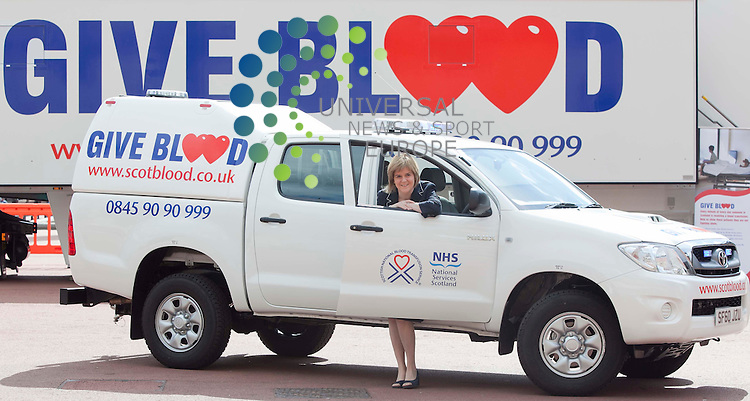 """Health Secretary Nicola Sturgeon, with the new """"blue Light"""" winter busting 4by4 emergency response vechicle Goerge Sq, one of new vehicles.for the Scottish National Blood Transfusion Service. Picture: Johnny Mclauchlan Universal News and Sport (Europe).14/07/2011"""