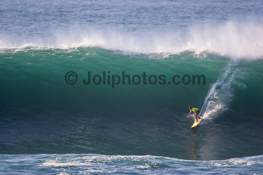 Waimea Bay, North Shore, Oahu, Hawaii December 15 2004.<br /> Bruce Irons (HAW) - The 2004 Quiksilver Eddie Aikau Big Wave Invitational won by Hawaiian surfer Bruce Irons (HAW) from the island of Kauai was held in 30 to 40' waves at Waimea Bay on the North Shore of Oahu Hawaii, today, December 15th 2004. Irons rode one of the biggest waves of the day which was at least 30' in height, taking home US$55,000 in prize money.  Photo: Joliphotos.com