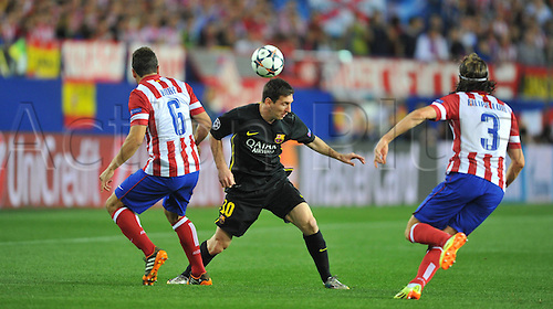 09.05.2014 Madrid, SPAIN . UEFA Champions League Quarter-finals 2nd leg, match played between Atletico de Madrid versus F.C. Barcelona at Vicente Calderon stadium.  Koke (Atl. Madrid) - Lionel Messi (FC Barcelona) - Filipe Luis (Atl. Madrid)