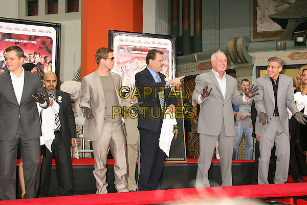 "MATT DAMON, BRAD PITT, JERRY WEINTRAUB & GEORGE CLOONEY.""Ocean's Thirteen"" Handprint and Footprint Ceremony held  at Grauman's Chinese Theatre, Hollywood, California, USA..June 5th, 2007.full length grey gray suit beige towel dirty hands palms .CAP/ADM/RE.©Russ Elliot/AdMedia/Capital Pictures"