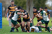 Etuale Pitone tries to fend of David Poasa-Osofua as he makes a break from broken play. Counties Manukau Club Rugby game between Manurewa and Bombay played at Mountfort Park Manurewa on Saturday June 2nd 2018. Bombay won the game 27 - 20 after leading 20 - 5 at halftime. <br /> Manurewa Kidd Contracting 20 - Caleb Fa'alili, William Raea, Willie Tuala, Viliami Taulani tries.<br /> Bombay 27 - Liam Daniela, Sepuloni Taufa, Talaga Alofipo tries, Ki Anufe 3 conversions, Ki Anufe 2 penalties.<br /> Photo by Richard Spranger.