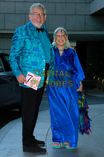 ROLF HARRIS & WIFE.Attending Barbara Windsor's 70th Birthday Party, .Royal Garden Hotel, London, England, August 5th 2007..full length blue patterned print turquoise jacket dress .CAP/CAN.©Can Nguyen/Capital Pictures
