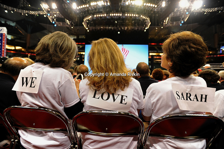 Colorado delegates show their support for John McCain's vice-presidential pick, Sarah Palin, on the floor of the XCel Center as the Republican National Convention kicks off its first day of muted activities due to Hurricane Gustav in Saint Paul, Minnesota on September 1, 2008.