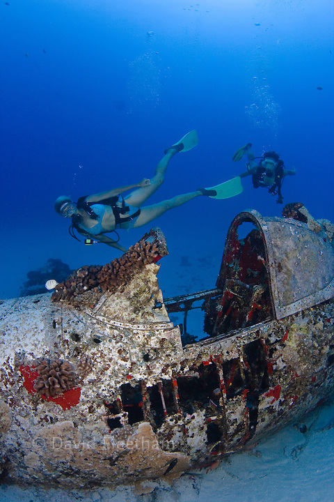 Divers (MR) on a WW II Corsair fighter plane off South-East Oahu, Hawaii.
