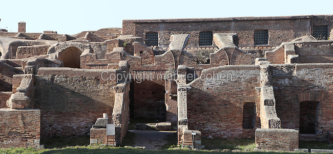 Casseggiato del Larario (House of the Lararium), 1st century AD, Ostia Antica, Italy. Storage building called Small Market, 2nd century AD, visible in the background. Picture by Manuel Cohen