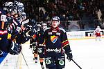 Stockholm 2014-02-24 Ishockey Hockeyallsvenskan Djurg&aring;rdens IF - S&ouml;dert&auml;lje SK :  <br /> Djurg&aring;rdens Henrik Eriksson gratuleras av lagkamrater efter sitt 3-1 m&aring;l i slutet av matchen<br /> (Foto: Kenta J&ouml;nsson) Nyckelord:  jubel gl&auml;dje lycka glad happy