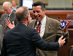Nevada Gov. Brian Sandoval jokes with Sen. Mark Hutchison at the Legislative Building in Carson City, Nev., on Wednesday, April 3, 2013..Photo by Cathleen Allison