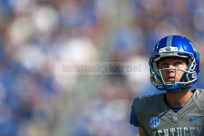 Kentucky Wildcats redshirt-freshman kicker Austin MacGinnis(99) waits to kick a 53-yd field goal which tied a school record during the first half against the Ohio Bobcats at Commonwealth Stadium on Saturday, September 6, 2014 in Lexington, Ky. Kentucky defeated Ohio 20-3. Photo by Michael Reaves | Staff
