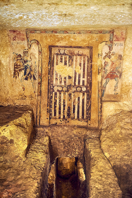 "Underground Etruscan tomb ""Tomba dei Caronti"" made about 150-125 BC. This tomb has a higher level with 2 painted false doors that was furnished with seats as was probably used for religious functions, steps lead down to a lower burial chamber. Excavated 1960 , Etruscan Necropolis of Monterozzi, Monte del Calvario, Tarquinia, Italy. A UNESCO World Heritage Site."