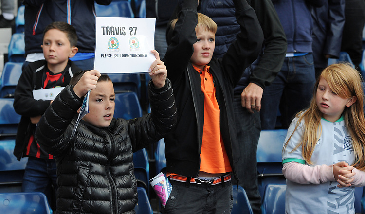 A young Blackburn Rovers fan holds up a sign for Lewis Travis<br /> <br /> Photographer Kevin Barnes/CameraSport<br /> <br /> The EFL Sky Bet Championship - West Bromwich Albion v Blackburn Rovers - Saturday 31st August 2019 - The Hawthorns - West Bromwich<br /> <br /> World Copyright © 2019 CameraSport. All rights reserved. 43 Linden Ave. Countesthorpe. Leicester. England. LE8 5PG - Tel: +44 (0) 116 277 4147 - admin@camerasport.com - www.camerasport.com