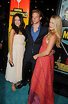 LOS ANGELES, CA - OCTOBER 18: Abigail Spencer, Jonny Weston and Leven Rambin arrive at the 'Chasing Mavericks' - Los Angeles Premiere at Pacific Theaters at the Grove on October 18, 2012 in Los Angeles, California.