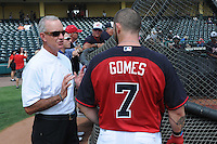 Atlanta Braves General Manager John Hart talks with Jonny Gomes (7) around the batting cage before a Spring Training game against the New York Yankees on Wednesday, March 18, 2015, at Champion Stadium at the ESPN Wide World of Sports Complex in Lake Buena Vista, Florida. The Yankees won, 12-5. (Tom Priddy/Four Seam Images)