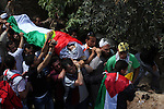 Palestinian mourners carry the body of Issam Badran during his funeral in the West Bank village of Qusra near Nablus, on Sept. 24, 2011. The 37-year-old Issam Badran was wounded by Israeli forces during a demonstration in Qusra village near Nablus city in the southern West Bank. He died shortly after being sent to hospital, according to medics. Photo by Issam Rimawi