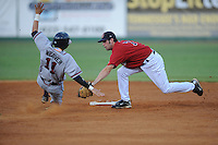 Derek McCallum Second Baseman Elizabethton Twins (Minnesota Twins) tags out a sliding Matt Weaver of the Danville Braves (Atlanta Braves) at Joe O'Brien Stadium August 17, 2009 in Elizabethton, TN (Photo by Tony Farlow/Four Seam Images)