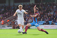 Peterborough United's Matthew Godden is tackled by Scunthorpe United's Rory McArdle<br /> <br /> Photographer Chris Vaughan/CameraSport<br /> <br /> The EFL Sky Bet League One - Scunthorpe United v Peterborough United - Saturday 13th October 2018 - Glanford Park - Scunthorpe<br /> <br /> World Copyright © 2018 CameraSport. All rights reserved. 43 Linden Ave. Countesthorpe. Leicester. England. LE8 5PG - Tel: +44 (0) 116 277 4147 - admin@camerasport.com - www.camerasport.com