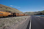 Please contact the photographer regarding licensing this image.  Thank You. Railroad cars and highway along the Snake River canyon near Wawawai, in Washington State Palouse country.  Demonstrates Parallax effect.