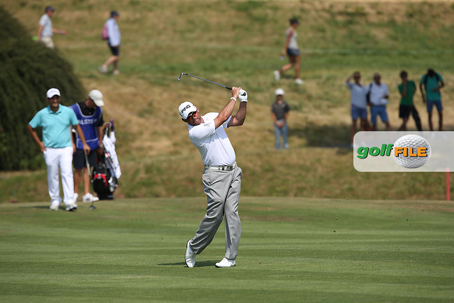 Lee Westwood (ENG) plays second shot to the first during Round One of the 2015 Alstom Open de France, played at Le Golf National, Saint-Quentin-En-Yvelines, Paris, France. /02/07/2015/. Picture: Golffile | David Lloyd<br /> <br /> All photos usage must carry mandatory copyright credit (&copy; Golffile | David Lloyd)