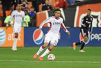 Washington, D.C.- March 29, 2014. Daigo Kobayashi (16) of the New England Revolution. D.C. United defeated the New England Revolution 2-0 during a Major League Soccer Match for the 2014 season at RFK Stadium.