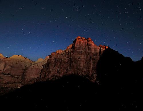 The bright light of a full moon illuminates the canyon walls at Zion National Park, Utah
