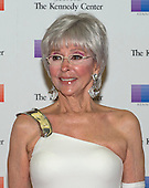 Singer Rita Moreno arrives for the formal Artist's Dinner honoring the recipients of the 38th Annual Kennedy Center Honors hosted by United States Secretary of State John F. Kerry at the U.S. Department of State in Washington, D.C. on Saturday, December 5, 2015. The 2015 honorees are: singer-songwriter Carole King, filmmaker George Lucas, actress and singer Rita Moreno, conductor Seiji Ozawa, and actress and Broadway star Cicely Tyson.<br /> Credit: Ron Sachs / Pool via CNP