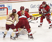 Meagan Mangene (BC - 24), Hillary Crowe (Harvard - 8), Blake Bolden (BC - 10), Kaitlin Spurling (Harvard - 17) - The Boston College Eagles defeated the visiting Harvard University Crimson 3-1 in their NCAA quarterfinal matchup on Saturday, March 16, 2013, at Kelley Rink in Conte Forum in Chestnut Hill, Massachusetts.