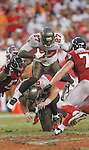 Tampa Bay Buccaneers running back LeGarrette Blount (27) has to hurdle teammate  Luke Stocker (88) to get a first down against the Atlanta Falcons. The Buccaneers defeated the Falcons 16-13 in an NFL football game Sunday, Sept. 25, 2011 in Tampa, Fla. (AP Photo/Margaret Bowles)