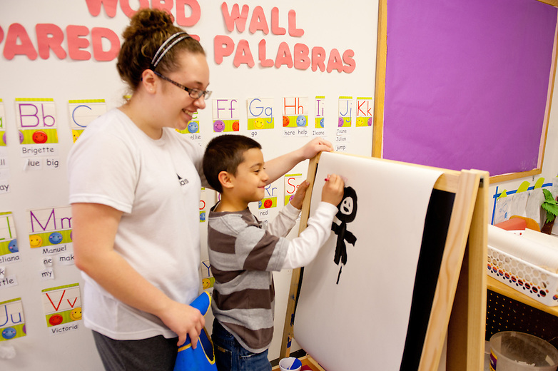 Curie High School students participate in buildOn's day of service at the Chicago YMCA on Touhy.