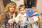 Eight years old Ciarán Foran Rumpler hands over his Birthday money to Joan Rogers, Animal Health Net Kerry.