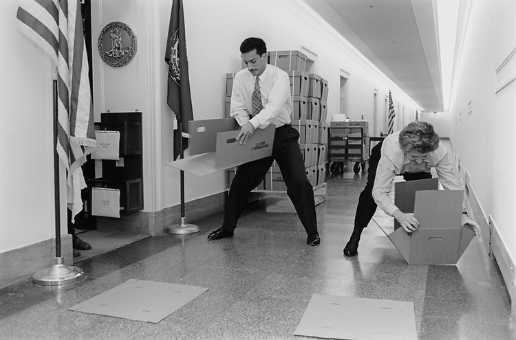 The staff of Rep. Leslie L. Byrne, D-Va., have gotten so good at assembling boxes that they have turned it into a competition (for our benefit) at the Longworth House Office Building. (Photo by CQ Roll Call via Getty Images)