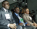 16 January 2004: Fourteen year old Freddy Adu (center) waits for the draft to start with his uncle Tony Yeboah (left) and his mother Emilia Adu (right). Freddy was taken as the number one pick overall by DC United. The Major League Soccer SuperDraft was held at the Charlotte Convention Center in Charlotte, NC as part of the annual National Soccer Coaches Association of America convention..